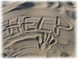 'HELP' written in the sand